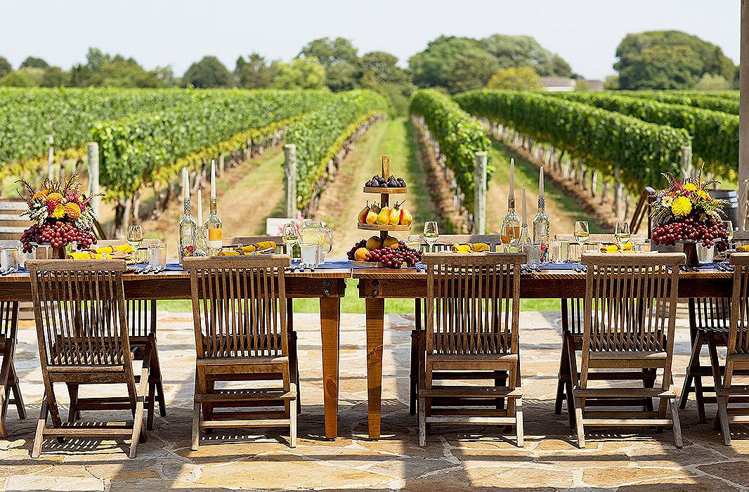 With tables set up on the terrace, guests enjoyed shade from the wooden pergola while taking in spectacular views of the acres of vines.