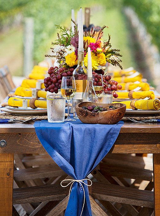 Tied with a length of twine, the linen table runner has an air of rustic elegance and easy charm.