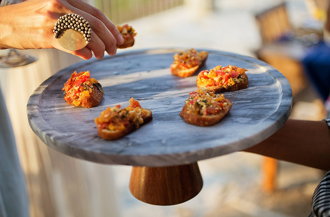 A marble-and-wood cake stand makes a simple yet lovely presentation for fresh bruschetta.