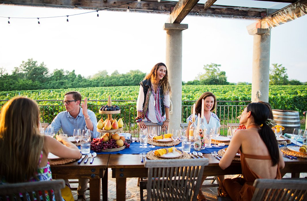 Two farm tables pushed together created one long communal gathering spot—and ensured that everyone got in on the conversation.