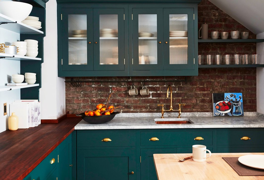 The kitchen at our Soho shop was custom-designed down to every last shelf and drawer pull. We chose a two-tone paint treatment and three countertop materials, which gives the kitchen the feeling of having been added to over time.