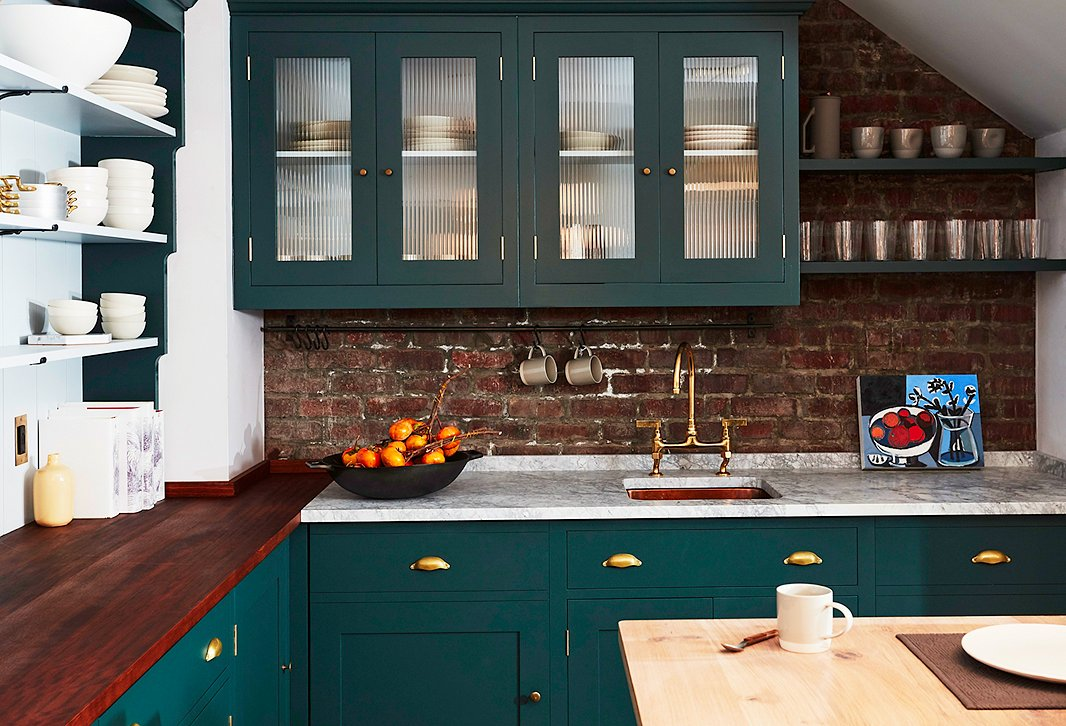 A rich green hue gives the shop's kitchen classic character.