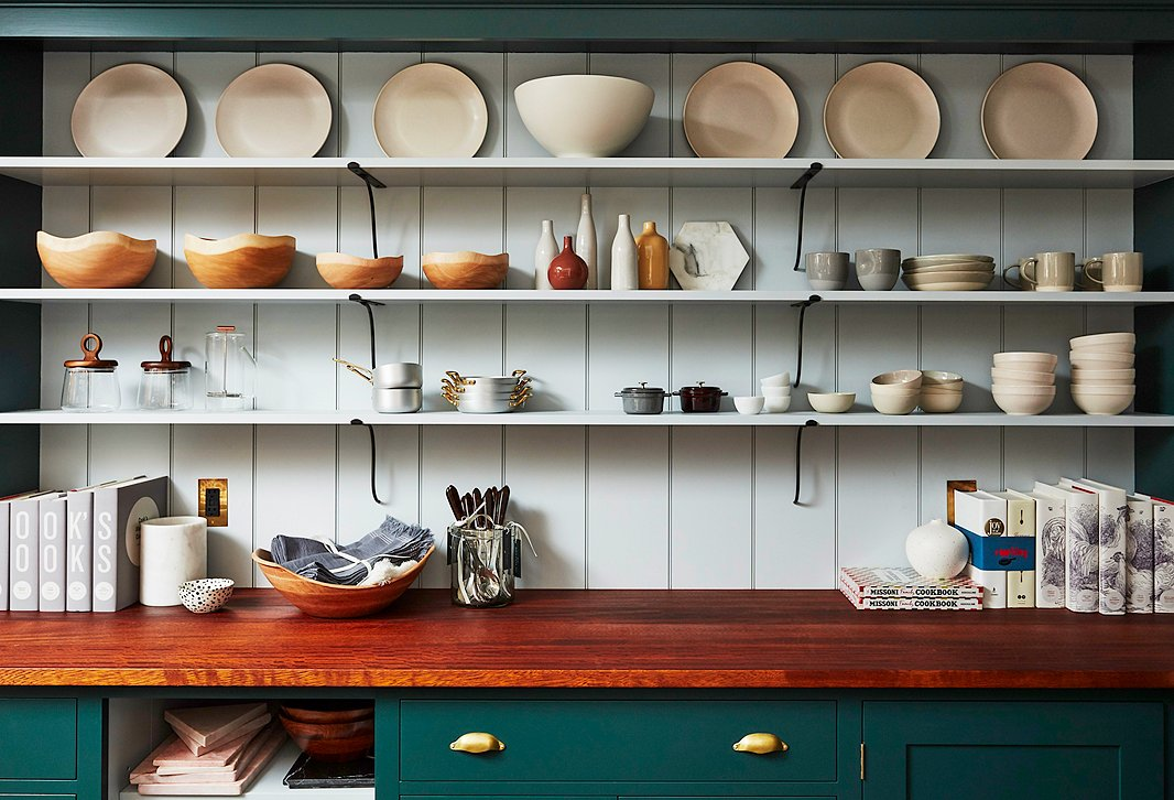 Open shelves display pieces by our favorite tableware brands, including icons such as Staub and small local makers including Franca.