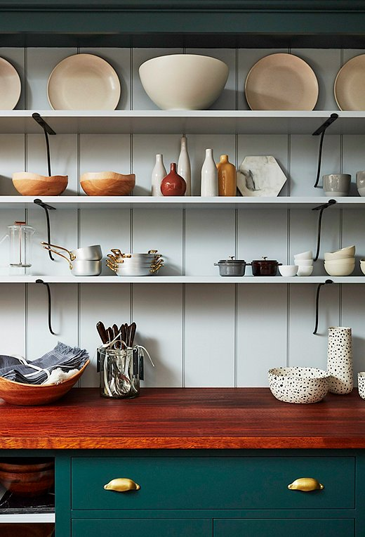 Mixing open and closed storage in a kitchen allows you to stow clutter out of sight while keeping favorite pieces on display. The shelves in our Soho shop hold a rotating collection of cookware and serving pieces by some of our favorite brands.