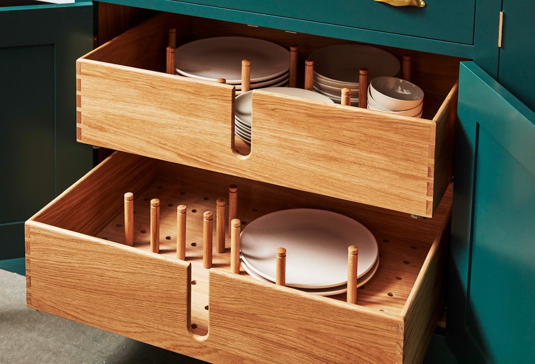 Plate drawers provide convenient access to items used every day—and make it easy for kids to help with setting the table. Movable pegs let you customize the configuration to your needs.