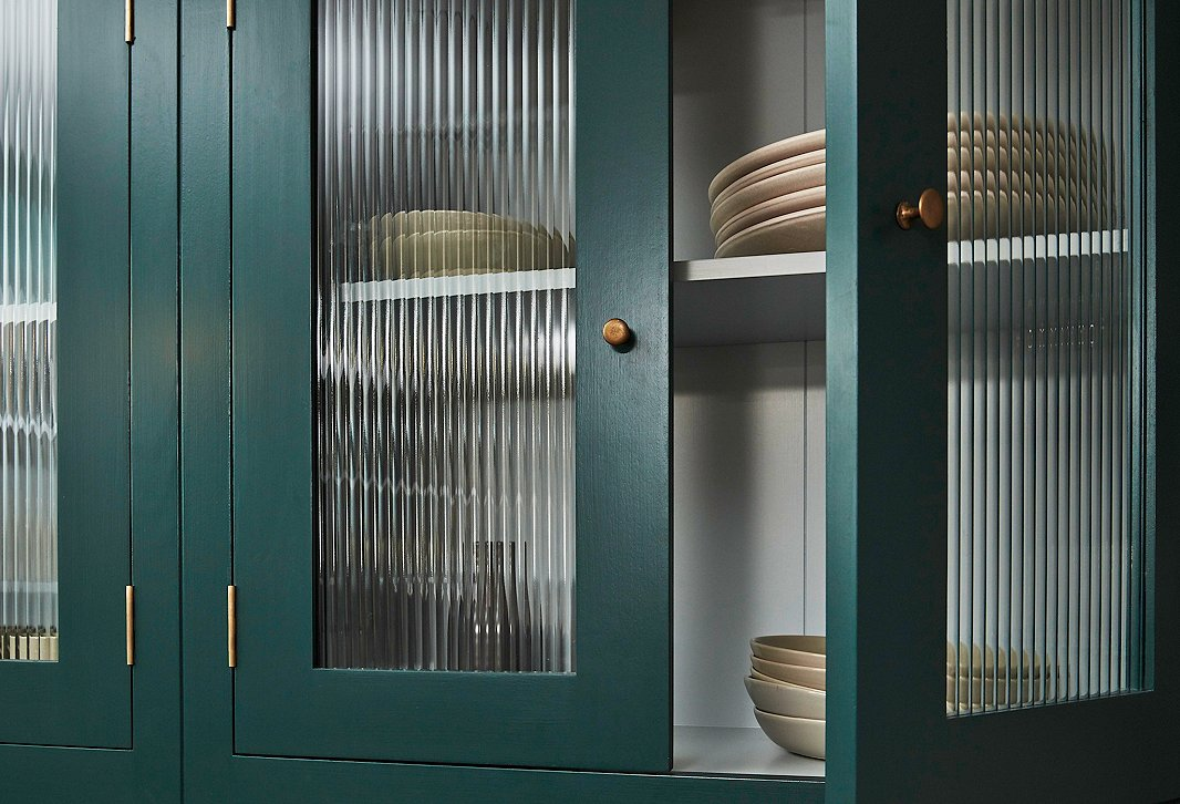 Cabinets with rolled-glass inserts lend lightness to the kitchen while giving the contents a cleaner, more uniform look.