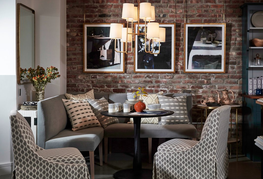 A petite pedestal table pulled up to a modular banquette offers a chic solution for small-space dining.