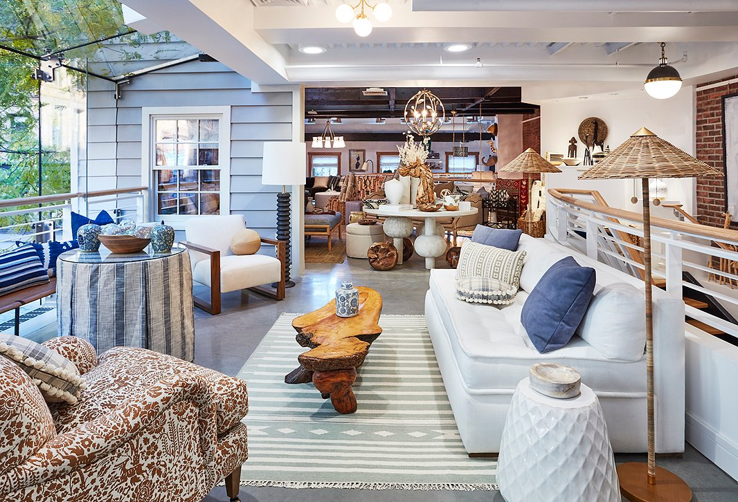 Upstairs, pieces in a classic blue-and-white palette make up a comfortable seating area with a hint of coastal charm.