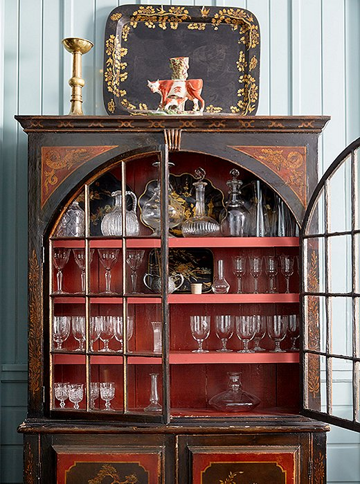 A chinoiserie bar cabinet in the dining room adds colorful contrast—and a well-traveled flair.