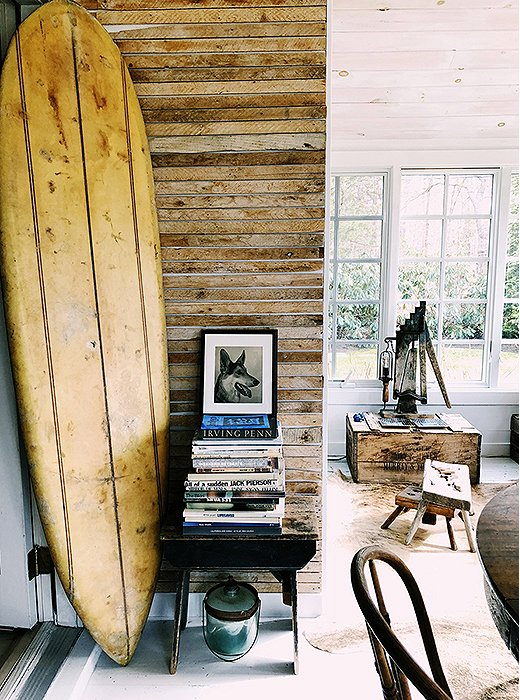 """I layer a lot by just resting artwork—placing objects on top of a stack of books or resting against a chair. I like to keep things loose and relaxed, because I'm always finding new things to add. It's a beach cottage, so I don't want it to feel or look too formal. Friends and guests should feel relaxed enough to walk around barefoot."""