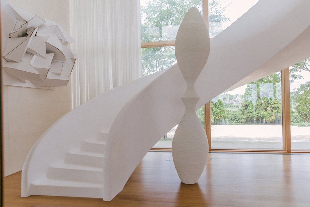 Off the entry is a custom staircase made of snow-white plaster, which Kelly says is incredibly soft on bare feet.