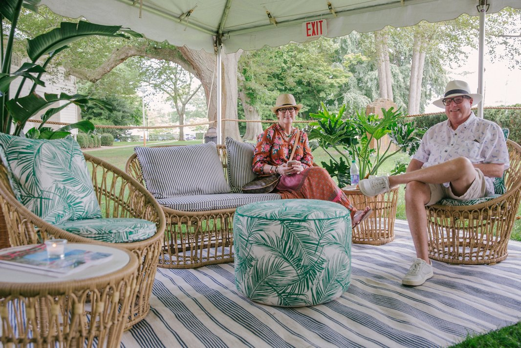 Guests enjoy a quiet moment on One Kings Lane's exclusive Palma outdoor furnishings at the Southampton shop.