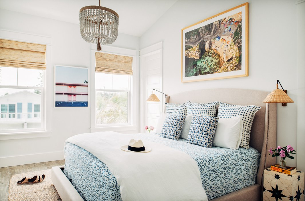 """I love mixing patterns and textures and prints,"" Hannah says—and she does so fearlessly, whether it's a bright banana-leaf fabric paired with a bold striped rug or a mix of three geometric prints on a bed, as in this dreamy master bedroom. ""I am of the mindset that if you love something, it will somehow work into the space."""