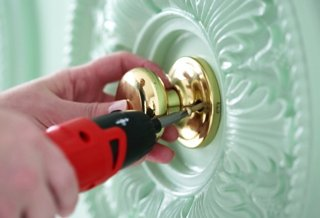 A 1-1/2\u2033 paintbrush makes painting all the little details of the medallion a snap. & A Chic DIY Closet Door Update