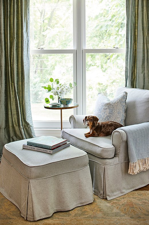 "Lola the dachshund makes herself comfortable in the bedroom reading nook. ""She packs a lot of personality into a little body!"""