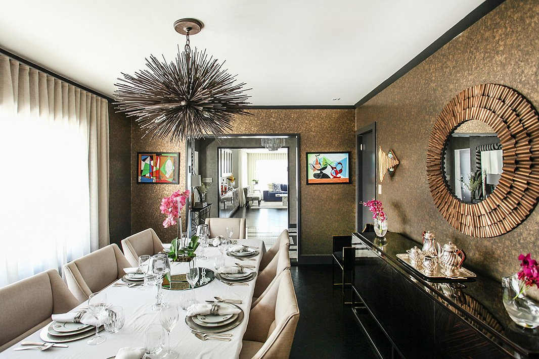 """The dining room keeps evolving,"" says Natalie, who regularly participates in designer show houses and has incorporated several pieces from those projects into this space. She picked up the pair of colorful artworks on a trip to Rome."