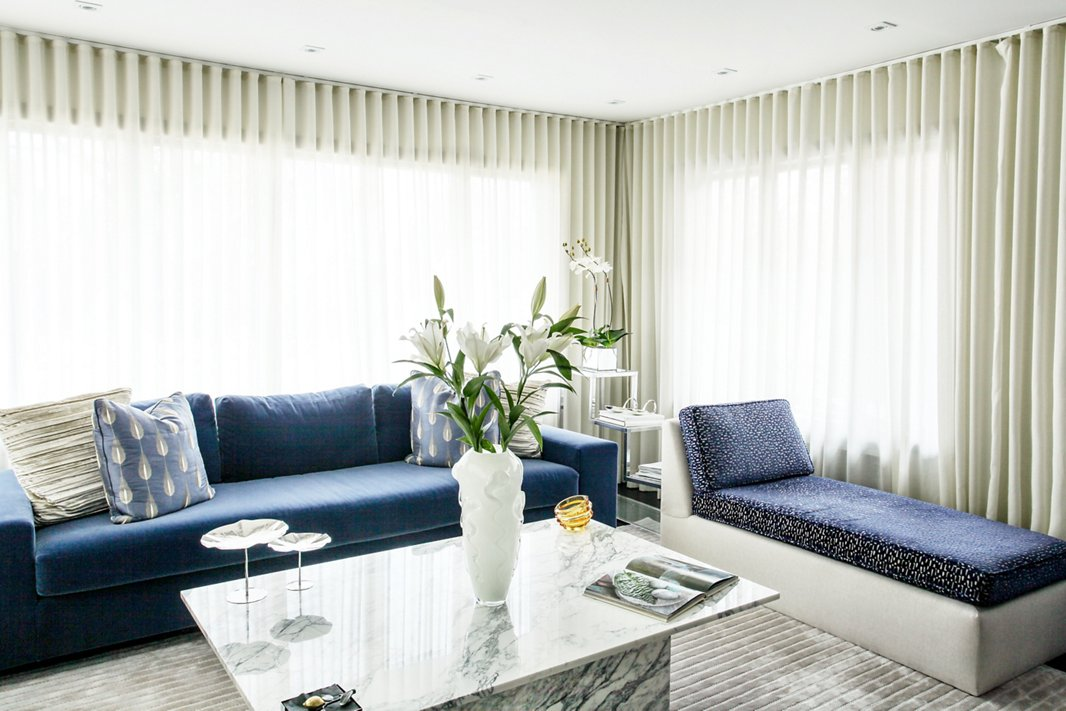 """I tend to be monochromatic but with lots of texture and contrast,"" says Natalie of her go-to design approach, which comes through in the living room's spectrum of blue and gray tones and touchable textures."