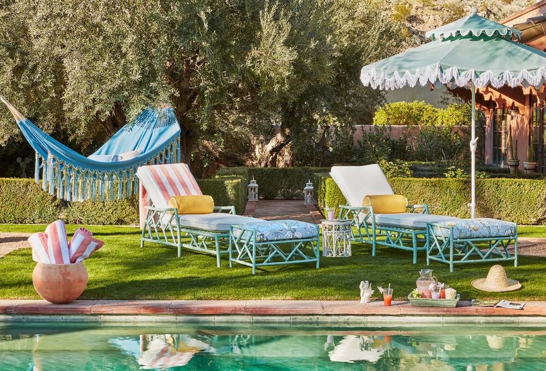 In hues of celadon, lemon yellow, and sky blue, outdoor furnishings from designer Celerie Kemble will turn your backyard, porch, or patio into a Palm Beach-style oasis.