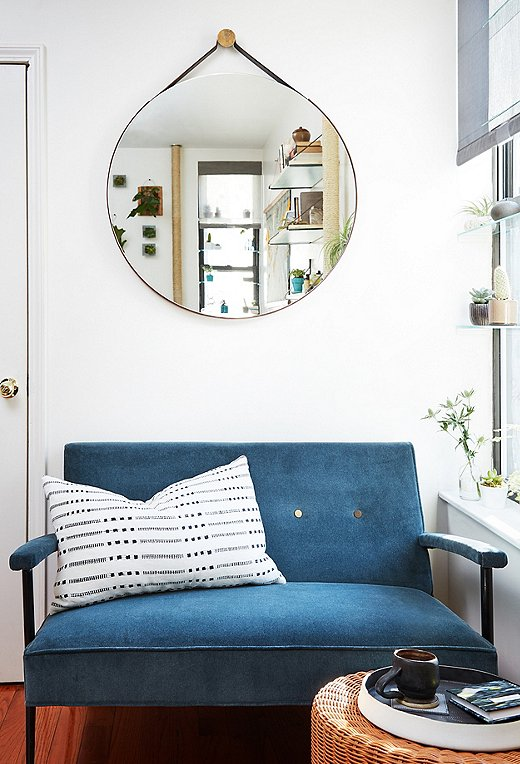 Shown: Vintage settee; round mirror (shop similar here); black-and-white pillow (shop similar here).
