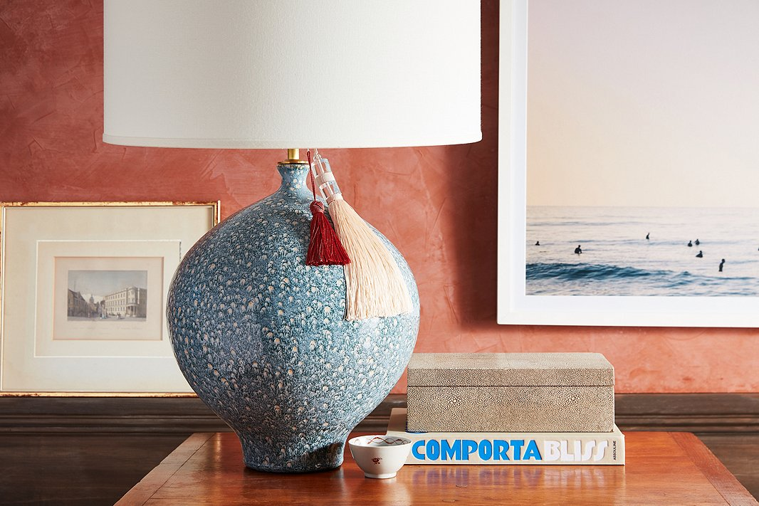 Try doubling up for a layered look. Here, two key tassels—one knotted, one beaded—add some playful texture to a ceramic table lamp.