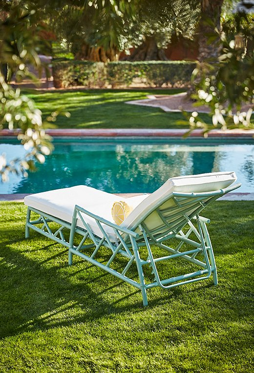 The Kit Chaise in celadon makes a perfectly stylish (and perfectly comfy) poolside perch.
