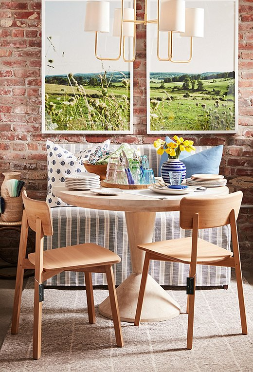 An upholstered banquette paired with a small table and a set of chairs is a smart solution for small-space dining.