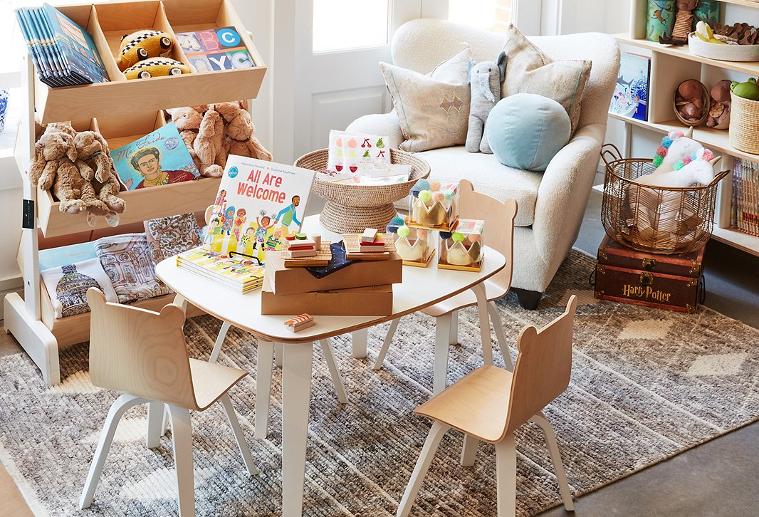 The playroom is filled with finds from favorite brands such as Meri Meri and furniture to keep all the toys and books nice and organized.