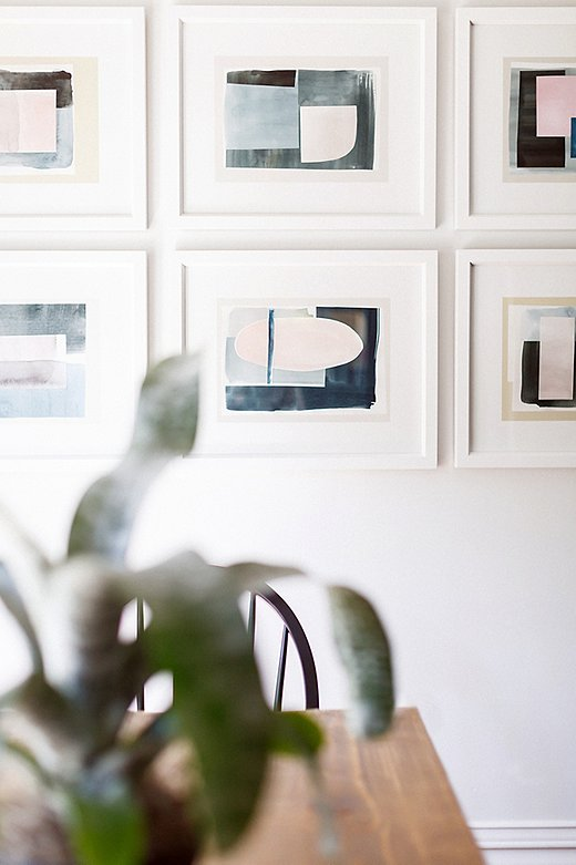 "Hung in a neat grid, this set of nine abstract prints has the impact of a single large-scale work. ""I love how the kitchen and breakfast area turned out,"" says Elizabeth. ""The space is bold yet calming at the same time."""