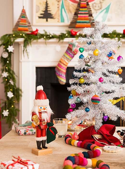 A holiday-hued fabric draped around the base of the kids' trees adds grown-up polish.