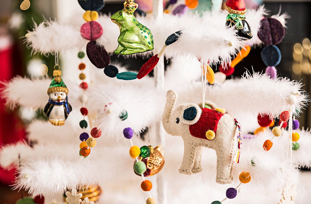 Try a mix of ornaments–let family heirlooms live among kid-friendly favorites like animals and gingerbread men. Felt options, like this elephant, are safe for even the littlest hands to hang.