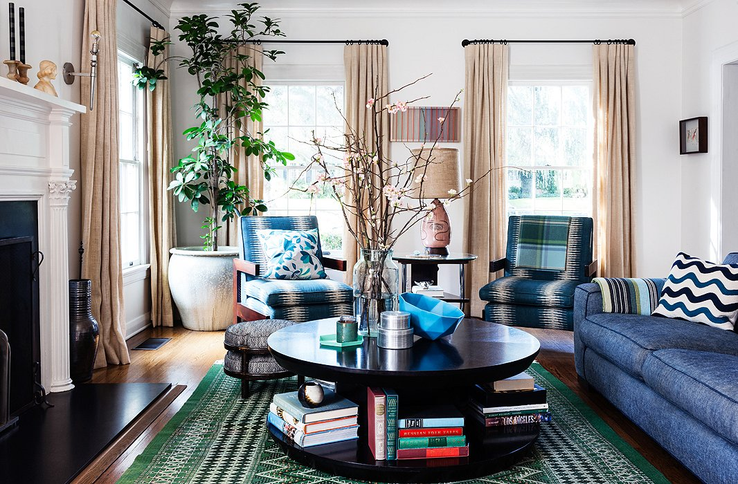 Blue, which runs throughout Christine's house, shows up in a major way in her living room: on a pair of chairs belonging to her husband that she had reupholstered, a Kelly Lamb geodesic bowl, and a beyond-comfy denim-upholstered sofa.