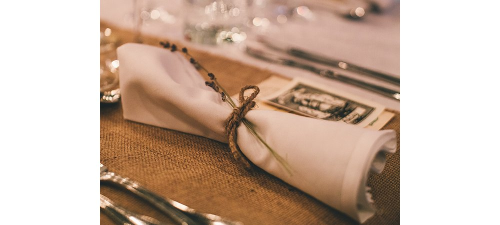 Each place setting was marked by a napkin tied with rope and scented with a sprig of lavender.