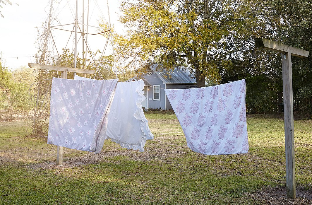 "Bedding by Rachel Ashwell dries on a line at The Prairie. Rachel heads to Round Top for market weeks and to host design workshops. ""It inspires me so much, it's not the place where I go necessarily to relax—it's usually quite a mission when I'm there!"""