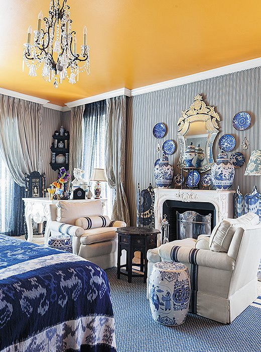In Michelle's Dallas master bedroom, a blue-and-white palette unifies all manner of prints and patterns, from classic ticking stripes to large-scale ikats.