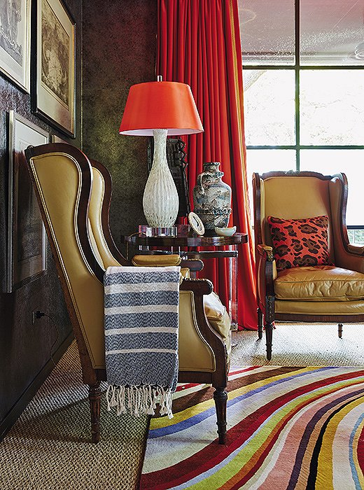 The TV room of Michelle's Dallas home is both cozy and calming in rich caramel and red tones. Touches of pattern in the pillow, the throw, and the rug are just enough to enliven the space's solid tones.