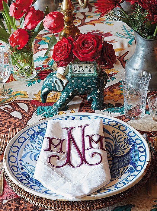 At her family's home in Switzerland, Michelle sets a pattern-happy table with blue-and-white Spanish plates, monogrammed napkins, and a bold floral tablecloth.