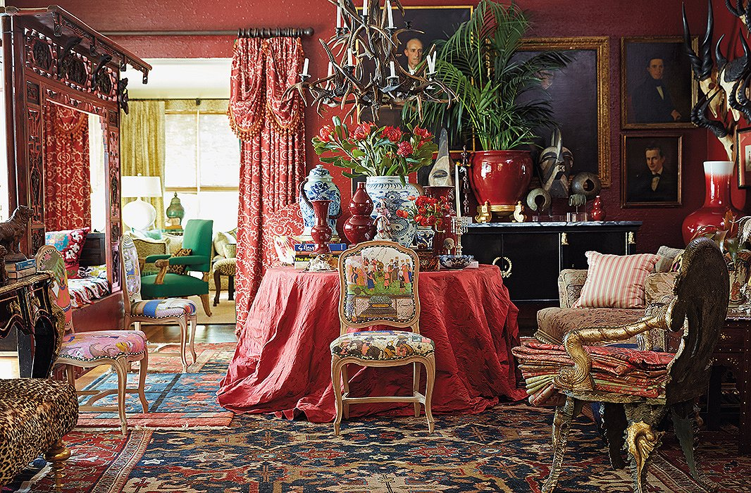 Michelle's favorite shade is a rich vermilion—and in her Dallas library, she's let the color flow from the walls to the furnishings to the floor. Amid the wash of color, a mix of worldly patterns feels unified.
