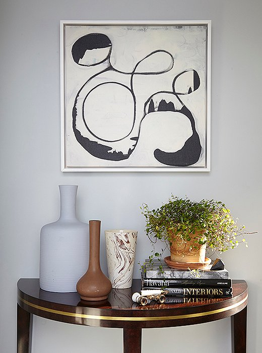 Every vignette presents another opportunity for clutter in a small apartment, so opt for a curated collection of goods, as this renter did.