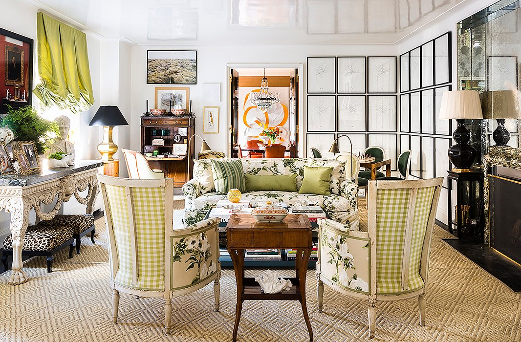 "A swatch of Bob Collins chintz lay dormant in Kate's ""fantasy file"" for seven years later, until it served as the driving force behind the design for her living room, taking center stage on a slipcovered sofa and two 19th-century Directoire-style bergères. ""I think it comes from having grown up in Los Angeles, where my mother has a wonderful green garden with a kind of lush Southern feel to it,"" says Kate of her affinity for the print. For an almost identical rug, see the Neptune."
