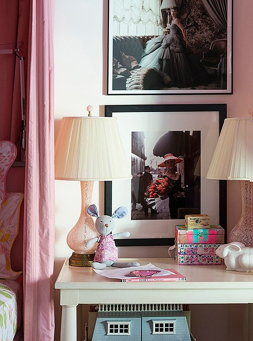 Fashion photographs are mixed with more-junior elements in the girls' room to create a mature space that's still age appropriate.