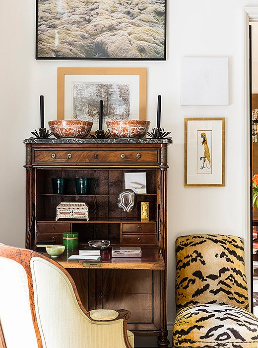 A birthday gift from Kate's mother, a slipper chair covered in tiger-print velvet offsets a secretary filled with small treasures.
