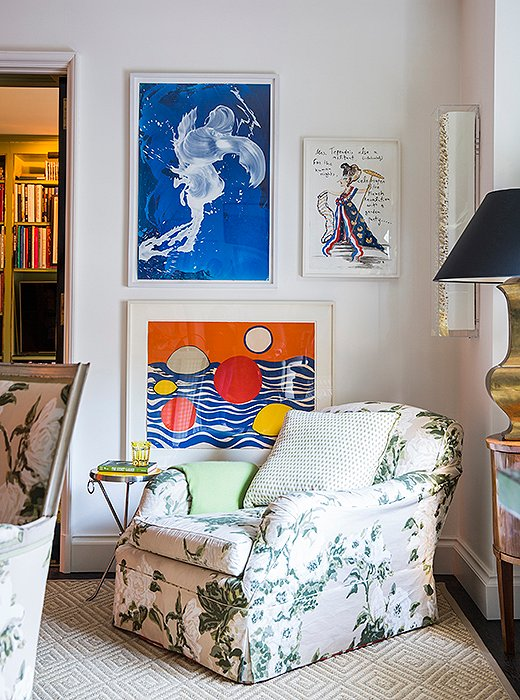 A roll-arm chair covered in the room's signature chintz serves as Alex's choice spot for a Saturday afternoon nap. Artwork by Alexander Calder and James Narse brings a touch of the modern to the otherwise traditional vignette.