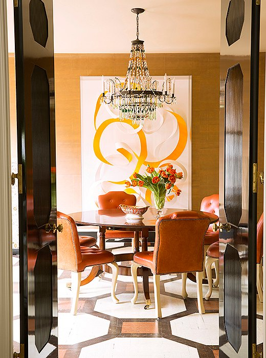 """Realistically, family dinner is a little hard for us,"" says Kate, ""because everyone's lives are so busy, but we do try to have breakfast together four or five days a week at the dining room table."" Beneath a vintage Regency-style table by Jonathan Burden sits a 19th-century Austrian chandelier opposite artwork by Janaina Tschäpe."