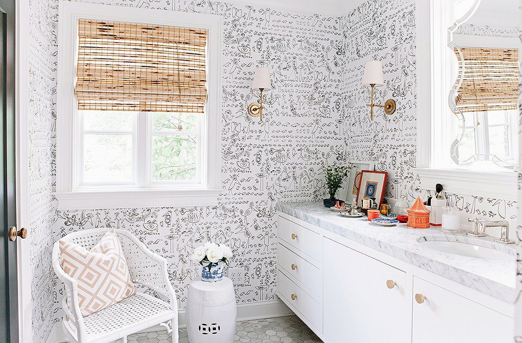 Fun whimsical wallpaper lightens up this master bath