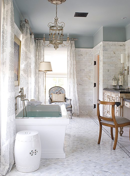 Love the elegant lighting and seating in this master bathroom