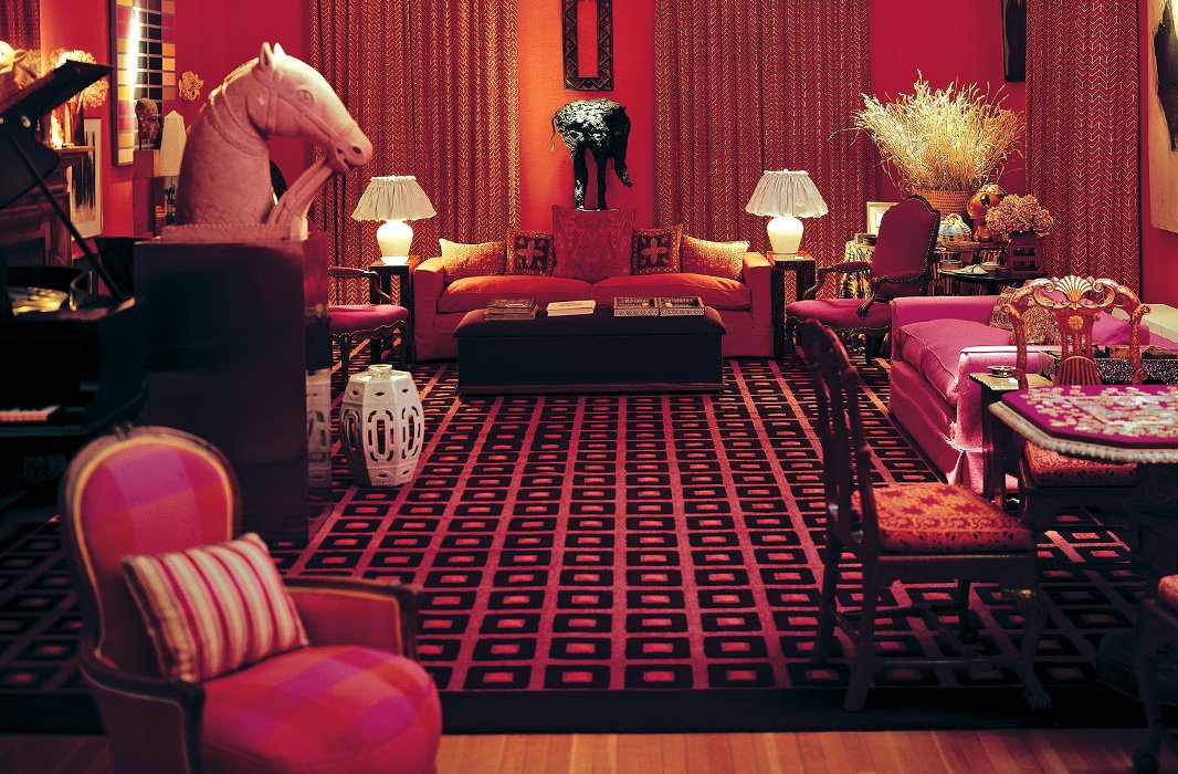 A rich red-and-pink palette sets off graphic silhouettes and layered patterns in a living room designed by David Hicks. Photo courtesy of Ashley Hicks