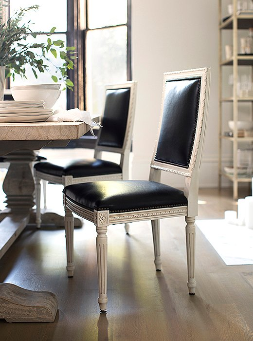 Upholstered in black leather, our Louis XVI-style Exeter chair takes on a modern edge. Photo by Michelle Drewes.