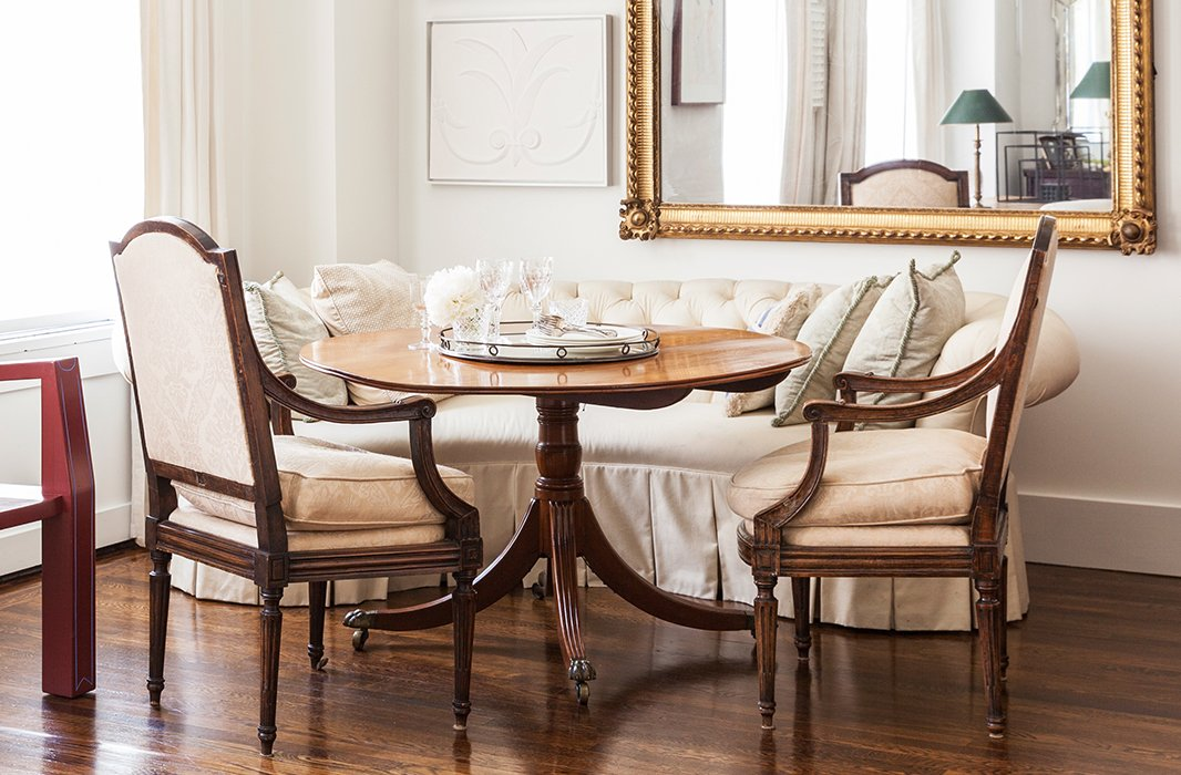 Loose seat cushions soften the angular lines of these Louis XVI armchairs.