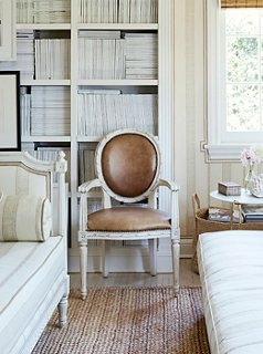 Leather Upholstery And A Crisp White Finish Add A Modern Touch To A  Round Back