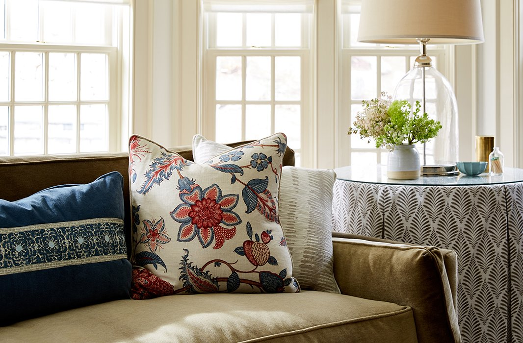 Among the prints that Debbie and Nicole brought into the family room are floral medallions, block-printed leaf motifs, and elaborate embroidered patterns that bringthe outdoors inside.